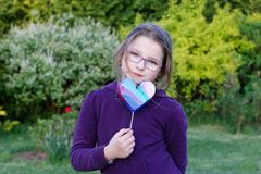 Girl. Little girl holding hand made heart on blurred background Stock Photo