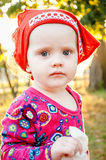 Little girl holding a handkerchief. Stock Photos