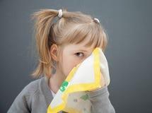 Little girl holding handkerchief Stock Photo