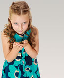 Little girl holding in hands a small turtle. Stock Images