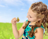 Little girl holding in hands a small turtle. Stock Image
