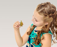 Little girl holding in hands a small turtle. Stock Photos