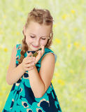 Little girl holding in hands a small turtle. Royalty Free Stock Photography