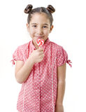 Little girl holding an hart shaped lollipop. Isolated on white stock photo