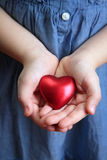 Little girl holding heart Royalty Free Stock Photo