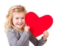 Little girl holding heart stock photo