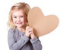 Little girl holding heart Stock Photos