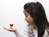 Little girl holding heart in his hands Royalty Free Stock Photo