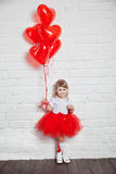 Little girl holding a heart-shaped ballon Royalty Free Stock Photography