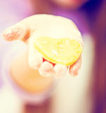 Little girl holding a heart-shaped dough Royalty Free Stock Photo