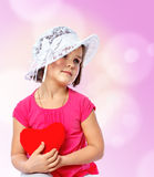 Little girl holding a heart Royalty Free Stock Images