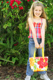 Little girl holding her bag Royalty Free Stock Photos
