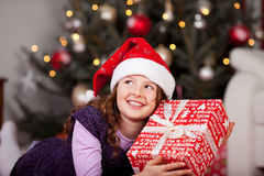 Little girl holding her Christmas gift Royalty Free Stock Images