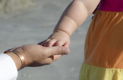 Little girl holding her dad's hand royalty free stock image