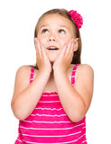 Little girl is holding her face in astonishment Stock Photo