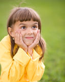 Little girl is holding her face. While listening to somebody Stock Photography