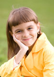 Little girl is holding her face. While listening to somebody Stock Images