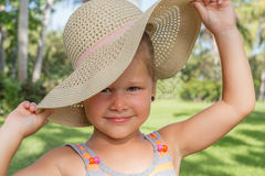 Little Girl Holding her Hat Royalty Free Stock Image