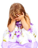 Little girl holding her head with both hands Royalty Free Stock Photos