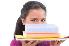 Little girl holding her homework and looking at camera Royalty Free Stock Photography