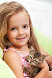 Little girl holding her kitten Stock Photo