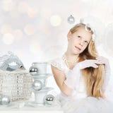 Little girl holding her long hair Stock Photo
