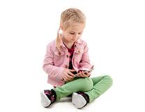Little girl holding her modern smartphone, isolated Royalty Free Stock Photos