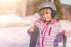 Little girl holding her skis Royalty Free Stock Photos