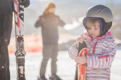 Little girl holding her skis Stock Photos