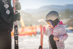 Little girl holding her skis Royalty Free Stock Image