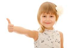 Little girl holding her thumb up Stock Image