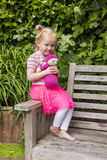 Little Girl Holding Homemade Crochet Doll In The Garden Royalty Free Stock Images