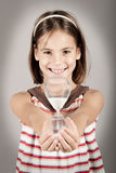 Little girl holding an hourglass Royalty Free Stock Photo