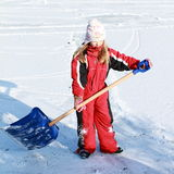 Little girl holding an ice-cleaner on pond Royalty Free Stock Image
