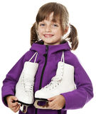 Little girl holding an ice skates Royalty Free Stock Photo