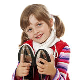 Little girl holding ice skates Stock Image