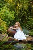 Little girl holding a jug Stock Photos