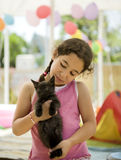 Little girl holding a kitten royalty free stock photography