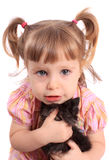 Little girl holding kitten Stock Images