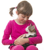 Little girl holding a kitten Royalty Free Stock Photos