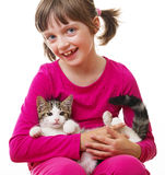 Little girl holding a kitten Stock Photography