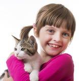 Little girl holding a kitten Royalty Free Stock Photo