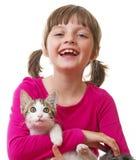 little girl holding a kitten Stock Image