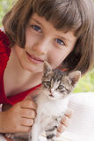 Little girl holding kitten Stock Image