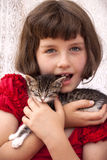 Little girl holding kitten Royalty Free Stock Photo