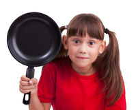 Little girl holding a frying pan Royalty Free Stock Photography