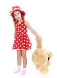 Little girl holding a large paw teddy bear Royalty Free Stock Photos
