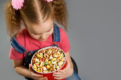 Little girl holding large popcorn bucket Stock Image