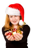 Little girl is holding little christmas presents. Isolated on white royalty free stock images