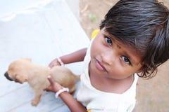 Little Girl Holding Little Dog Stock Photos
